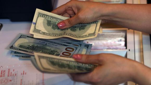 El depósito de la CTS debe ser efectuado por el empleador a nombre del trabajador, en moneda nacional o extranjera según la elección del empleado. (Foto: AFP)