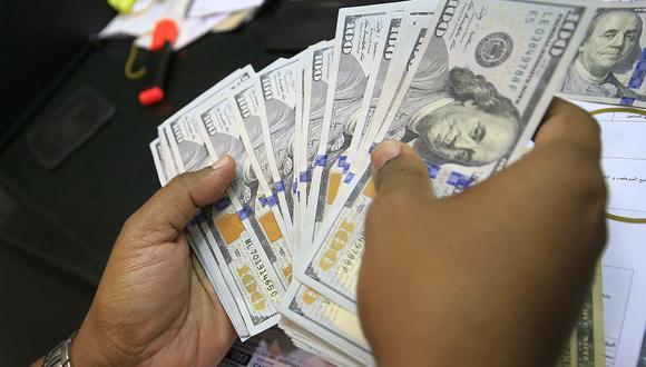 Hoy el tipo de cambio cotizaba a S/ 3.570 la compra y a S/ 3.600 la venta en el mercado paralelo. (Foto: AFP)
