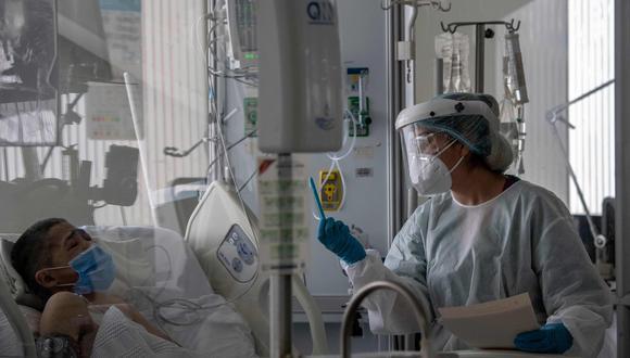 """""""Queremos alentar a los países a incrementar su nivel de alerta"""", dijo el gerente de incidentes para COVID-19 de la OPS, al pedir la """"implementación estricta"""" de las medidas de salud pública recomendadas. (Foto: AFP)"""