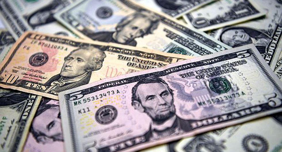 A nivel global, el dólar subía un 0,13% frente a una cesta de monedas de referencia este martes, según datos de Reuters. (Foto: AFP)