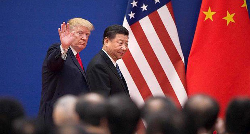 Donal Trump junto a su par chino, Xi Jinping, (Foto: AFP)