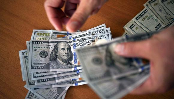 En el mercado paralelo o casas de cambio de Lima, el tipo de cambio se cotizaba a S/ 3.615 la compra y S/ 3.645 la venta. (Foto: AFP)