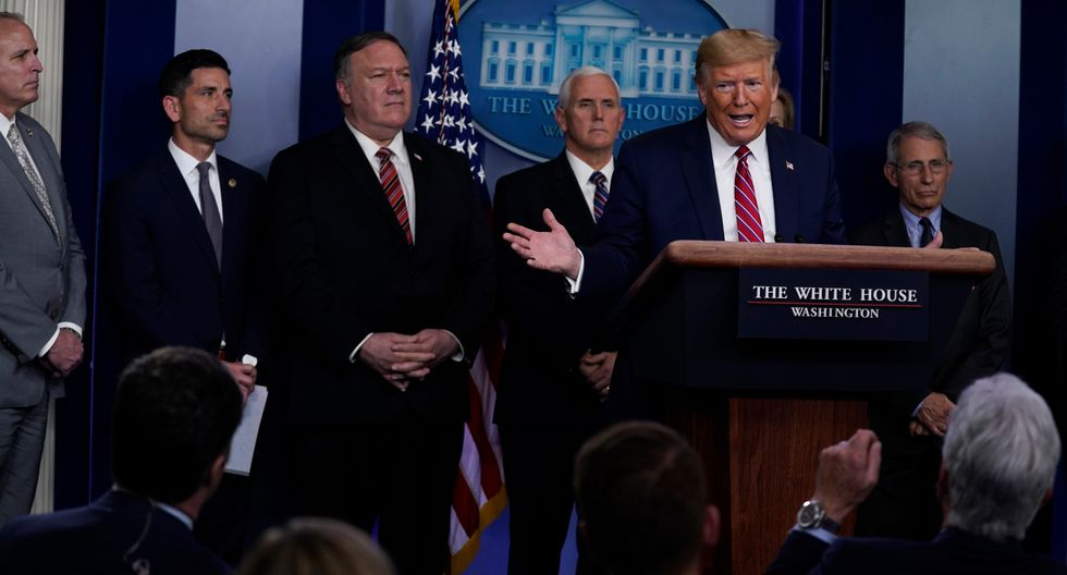 President Donald Trump responds to a question by NBC News White House correspondent Peter Alexander during a coronavirus task force briefing at the White House, Friday, March 20, 2020, in Washington. (AP Photo/Evan Vucci)