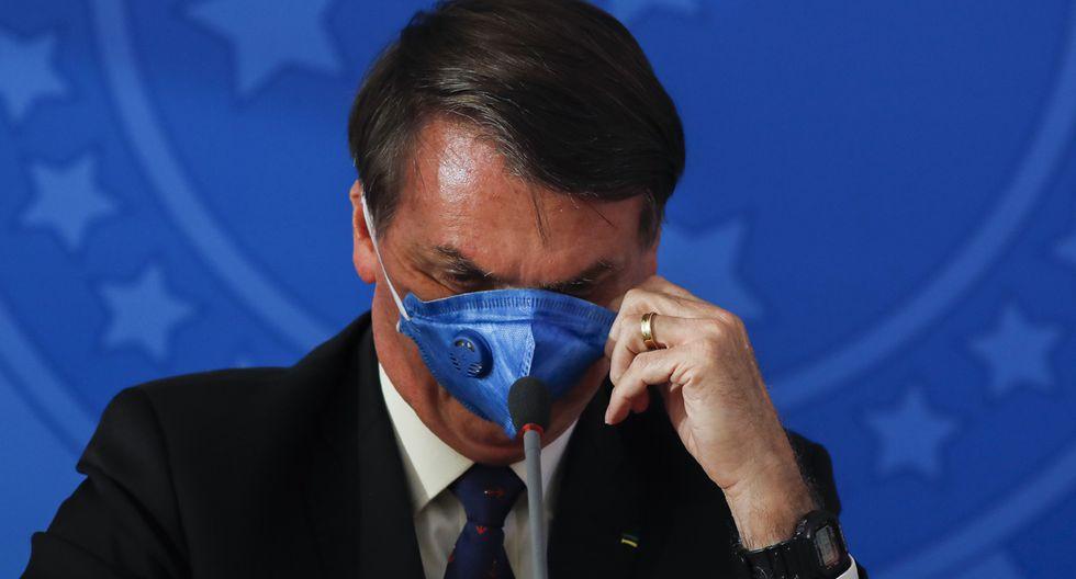 """Jair Bolsonaro llama al coronavirus como """"gripecita"""" o """"resfriadito"""" y ha exigido el fin del confinamiento masivo y ha pedido a los brasileños que vuelvan a trabajar. (Foto: AFP)"""