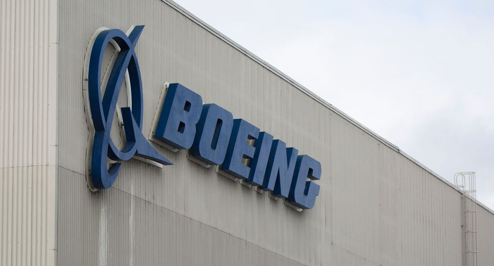 (FILES) In this file photo taken on March 12, 2019 the Boeing logo is pictured at the Boeing Renton Factory in Renton, Washington.  Boeing continues to target the fourth quarter for regulatory approval to return the 737 MAX to service after two deadly crashes, a spokesman said October 1, 2019. Boeing last week organized simulator tests for pilots from leading US carriers on new systems upgraded after two deadly MAX crashes. Boeing's changes received positive feedback, according to people familiar with the matter, boosting Boeing's hopes of meeting its target date. / AFP / Jason Redmond