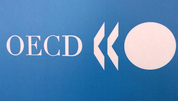 Ahora se espera que la economía mundial se recupere y crezca 5% el próximo año, dijo la OCDE. (Foto: JEAN AYISSI / AFP)