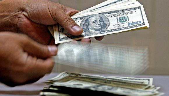 En el mercado paralelo o casas de cambio de Lima, el tipo de cambio se cotizaba a S/ 3.740 la compra y S/ 3.770 la venta. (Foto: AFP)