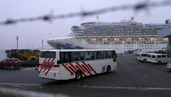 A coach bus travels towards the Diamond Princess cruise ship, operated by Carnival Corp., docked at dusk in Yokohama, Japan, on Sunday, Feb. 16, 2020. Aircraft chartered by the U.S. State Department are to arrive Sunday in Japan to evacuate about 400 citizens from the Diamond Princess. Photographer: Toru Hanai/Bloomberg