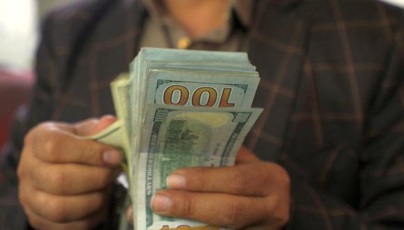 El dólar acumula una ganancia de 13.62% en el mercado cambiario peruano en lo que va del 2021. (Foto: AFP)