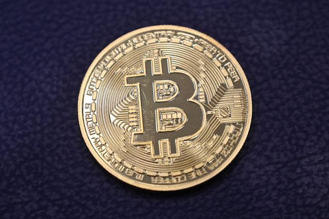 Multinationals such as Microsoft, Dell, Time Inc.  and Dish Network allow bitcoin payment, as well as Virgin Galactic and Reddit, among others.  (Photo: Ozan Kose / AFP)