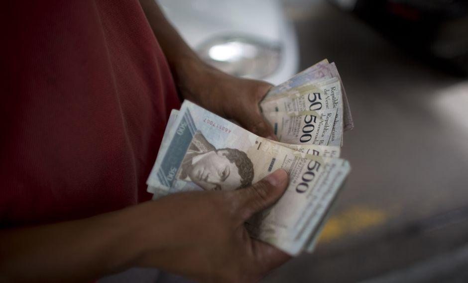 La moneda venezolana cerrará el año con una inflación de 1'000,000%. (Foto: AP)