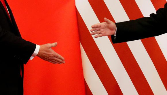FILE PHOTO: U.S. President Donald Trump and China's President Xi Jinping shake hands after making joint statements at the Great Hall of the People in Beijing, China, November 9, 2017. REUTERS/Damir Sagolj/File Photo/File Photo