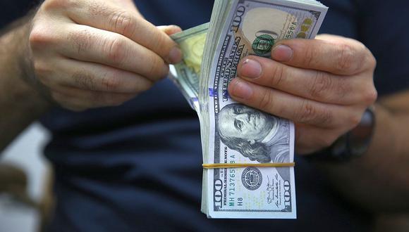 En el mercado paralelo o casas de cambio de Lima, el tipo de cambio se cotizaba a S/ 3.610 la compra y S/ 3.635 la venta. (Foto: AFP)