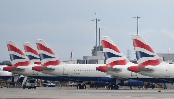 British Airways está actualmente en proceso de suprimir 13,000 puestos de trabajo, cerca de un tercio de su plantilla, y sin dar cifras Iberia también reconoció que deberá reducir sus efectivos debido al coronavirus. (AFP)