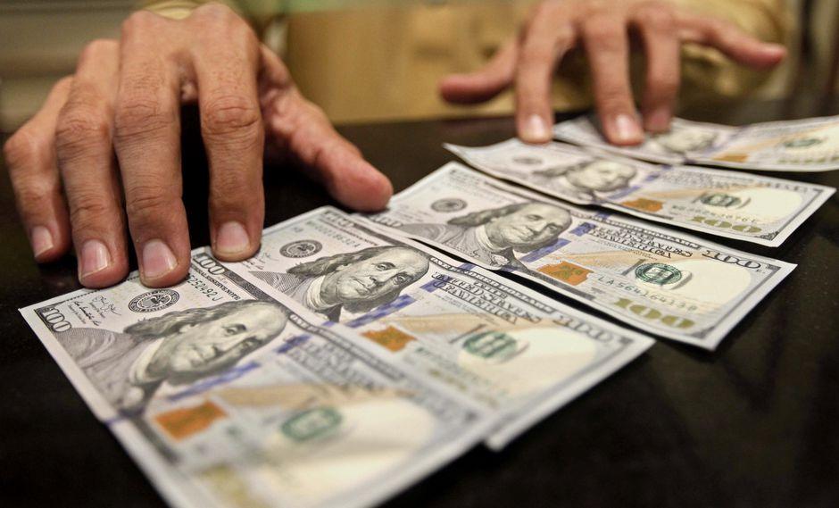 El dólar se cotizaba ayer a S/ 3.396. (Foto: EFE)