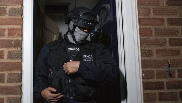 """La NCA dijo que esto también ayudó a que un equipo de especialistas pudiera impedir que bandas rivales llevaran a cabo secuestros y ejecuciones, """"neutralizando con éxito más de 200 amenazas a la vida"""". (AP)"""