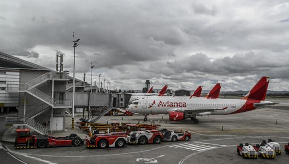 De acuerdo con el plan, Avianca convertiría US$ 902 millones de esa deuda en capital y recaudaría nuevos fondos para reemplazar la deuda restante, que incluiría capital nuevo. (Photo by Juan BARRETO / AFP)