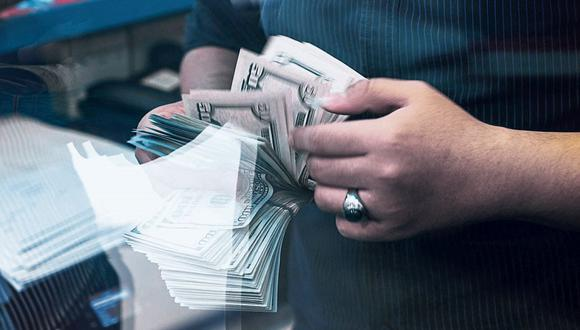 Dólar. Billete verde cayó de S/3.383 a S/3.291, en junio. (Foto: Bloomberg)