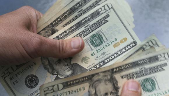 En el mercado paralelo o casas de cambio de Lima, el tipo de cambio se cotizaba a S/ 3.620 la compra y S/ 3.650 la venta. (Foto: AP)